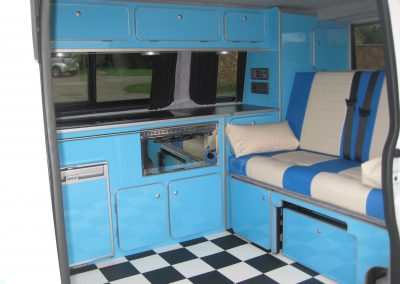 camper gallery CAMPER GALLERY rock and roll bed with knee roll blue and cream vinyl 1 400x284